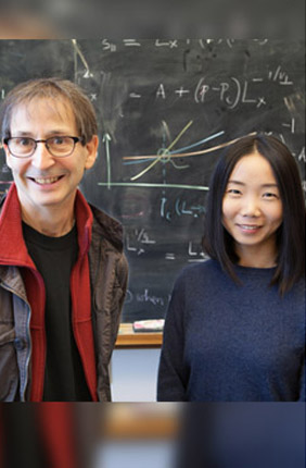 U of I Swanlund Professor of Physics Nigel Goldenfeld (left) works with colleague Chi Xue (right) at the Carl R. Woese Institute for Genomic Biology.
